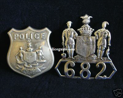Baltimore Police matched set of wreath and shield dating from 1890 - 1915.� This set was assigned to Officer James E. Schmidt of the Northern District. He was appointed in 1894 and served until 1923.