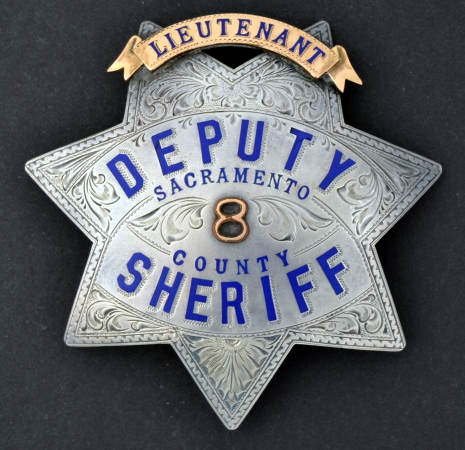 Sacramento County Lieutenant Deputy Sheriff badge #8. Made of sterling silver, hand engraved, hard fired blue enamel.  Lieutenant banner is gold front.
