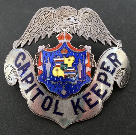 Capitol Keeper hat badge.  Sterling silver with hard fired blue enamel lettering and a custom multi colored seal.