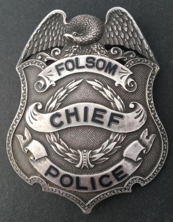 Chief of Police badges for Folsom, CA worn by Edward E. Fausset who was Folsom's first Chief from 1946 until his death in 1951.