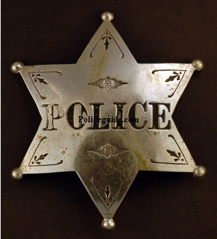 Rochester IN Police badge worn by Mel True.