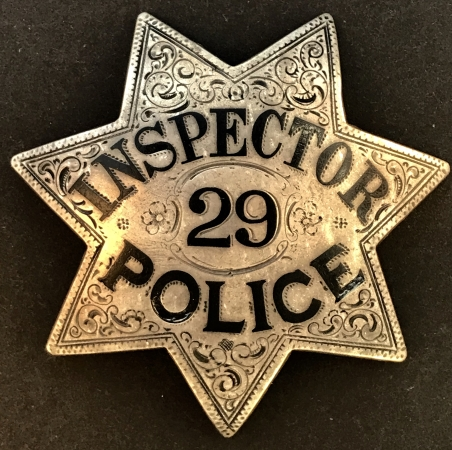 Oakland Police Inspector badge #29 worn by Lucien M. Jewell who was born 5-10-1898 and was appointed to the department on 5-18-1921.  By 1925 he was listed as Inspector.