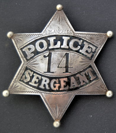 Los Angeles Police Sergeant badge #14, sterling silver, hand engraved.