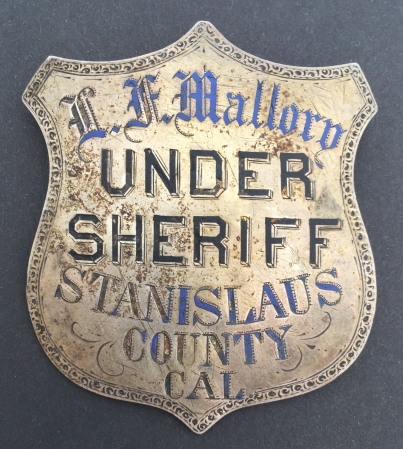 In January of 1881 L. F. Mallory became the Under Sheriff of Stanislaus County, CA.  His badge is made of sterling silver, has hard fired enamel and is hand engraved.