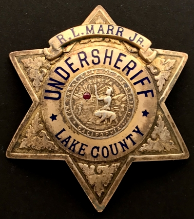 R. L. Marr Jr. Undersheriff Lake County badge made by Irvine & Jachens.  Gold filled and sterling.  Dated 1-22-42