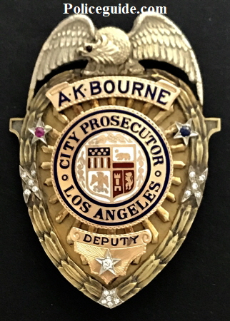 A. K. Bourne was presented with this 14k & 18k gold Deputy Prosecutor Los Angeles Co. badge hallmarked Everard & Co.  It is adorned with 16 diamonds, 1 ruby & 1 sapphire.