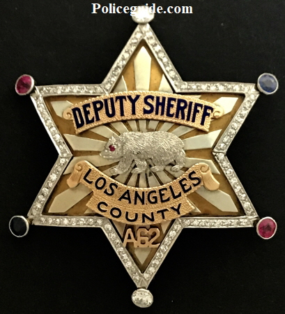 Arthur K. Bourne�s 14k gold Los Angeles Co. Deputy Sheriff badge adorned with 98 diamonds, 2 saphires and 2 rubies.  Presented to him by Wm. I. Traeger Sheriff Los Angeles.  Arthur K. Bourne was heir to the Singer Sewing Machine fortune and friend of law enforcement.
