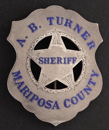 Sheriff Turner served from 1919-1927.  Badge is sterling silver with hard fired blue enamel.