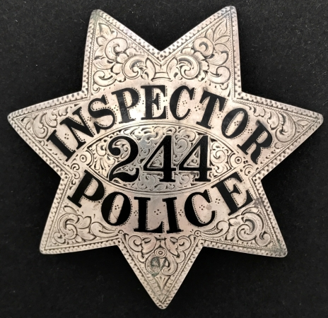 Oakland Police Inspector #244, worn by Inspector Clyde Archibald Crosswell who was appointed 12-1-22.  Sterling silver, hand engraved with hard fired enamel lettering.�