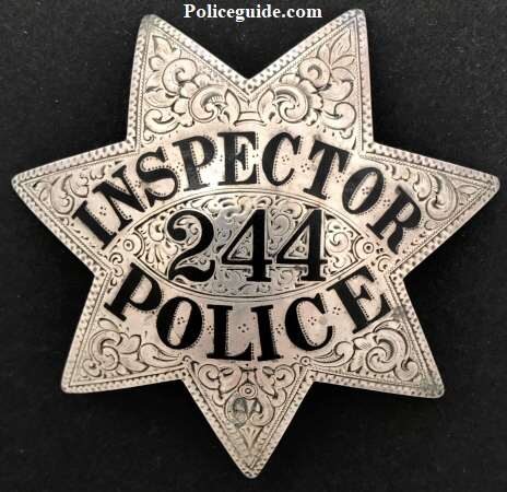 Oakland Police Inspector #244, worn by Inspector Clyde Archibald Crosswell who was appointed 12-1-22.  Sterling silver, hand engraved with hard fired enamel lettering.
