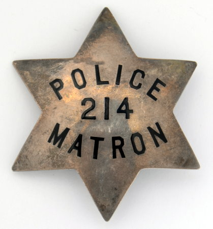 Matron Oakland Police #214 issued to Mrs. A.M. Shefoff who was appointed Matron 4-2-20. Sterling silver, hard fired enamel lettering. Hallmarked California.