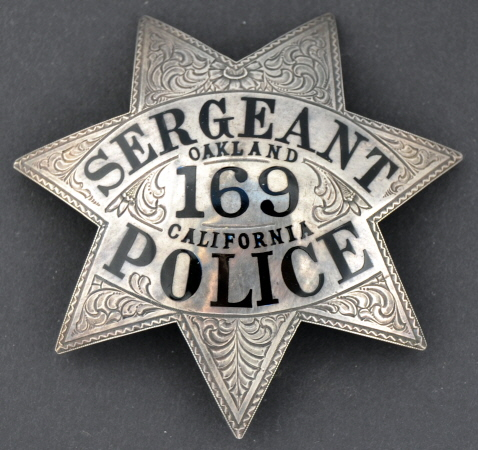 Oakland Police Sergeant #169.  Presentation on obverse:  Presented to Eric Gustavson  Feb. 1, 1947 By Members of the Camaraderie.  Sterling silver with hand engraving and hard fired black enamel.