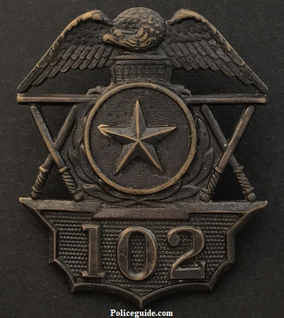 Hat badge 102.