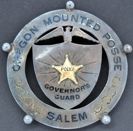 Oregon Mounted Posse, Governor's Guard, Salem.  Badge is made of sterling silver with a gold applied star in the center.