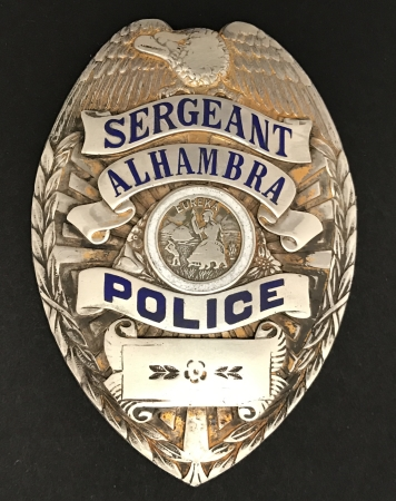 Sergeant Alhambra Police.� Sterling silver with a gold wash, circa WWII, hallmarked Entenmann.