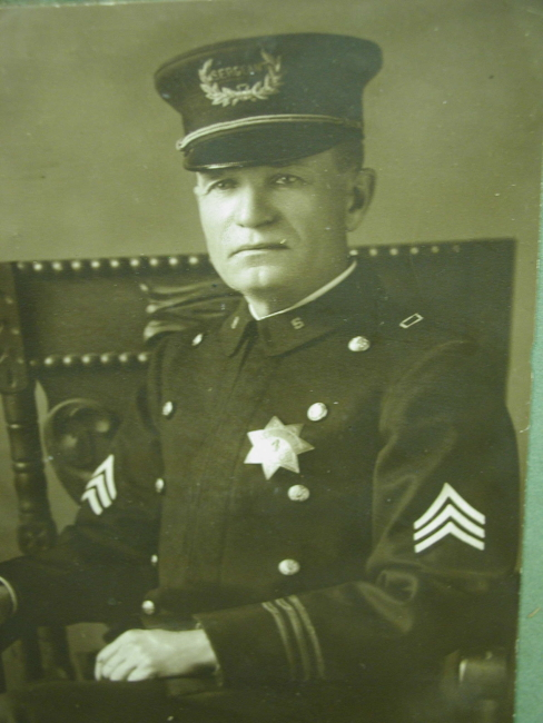 Sgt. Max Fisher wearing badge #4.
