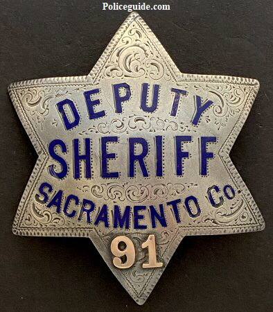 Sacramento County Deputy Sheriff badge #91. Made of sterling silver, hand engraved, hard fired blue enamel with applied gold numbers.