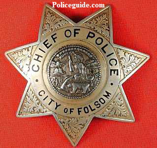 Chief of Police badges for Folsom, CA worn by Edward E. Fausset who was Folsom's first Chief from 1946 until his death in 1951. Badges were obtained from his son, Wm. Fausset on April 6, 1987.
