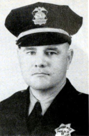Sacramento Sergeant of Police Patrick Bennett wearing badge number 9, Circa 1940.