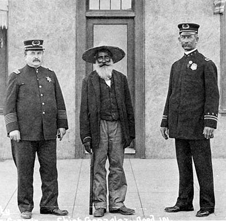 Circa 1911:� Captain Moriarty standing with Antonio Gonzales who was the Chief of the 1838 Mexican Town Police and standing on the right is Chief Keno Wilson.