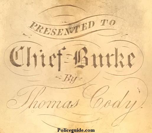 Reverse of Chief Martin Burke�s badge showing the presentation.
