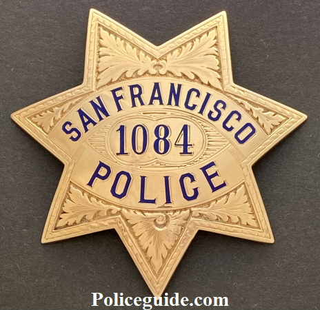 "This 14k gold badge was presented to San Francisco Police Officer John J. McLaughlin by fellow officers of the Harbor Police Station for ""Act of Bravery on December 25, 1927.  McLaughlin was appointed to the department on October 1, 1924.  The badge is hallmarked Irvine & Jachens and marked 14k."