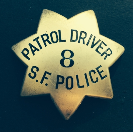 Sterling silver San Francisco Police Patrol Driver badge #8, made by Samuels Jewelry. Issued to William P. Griffin, who was appointed April 30, 1934.  Later to be worn by Spike Hennessey.