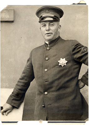 Photo of Spike Hennessey, San Francisco Police Patrol Driver wearing badge #8,
