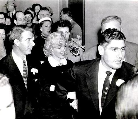 Reno Barsocchini leading newlyweds Marilyn Monroe and Joe DiMaggio as they left the wedding ceremony.