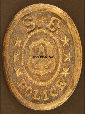Early San Francisco Police custom die belt buckle and pictured to the right is Lt. Frederick Esola wearing a similar buckle.