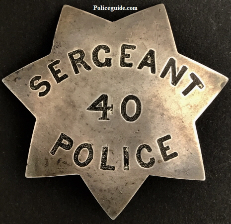 Philip Edward Fraher�s San Francisco Police officer and Sergeant  badge #40.   This badge was first used as a police officer badge and when the Fraher was promoted to Sergeant the badge was reversed and restamped.