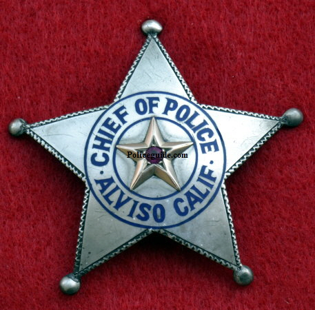 Chief Bacigalupi was not impressed with the badge and wanted one more fitting to his office.   Some time in 1921 he was presented with the sterling silver badge shown above right.  However, before the presentation was made the Mayor and friends of the Chief presented him with an enormous badge adorned with a bicycle refector in the center as a joke. See picture below.