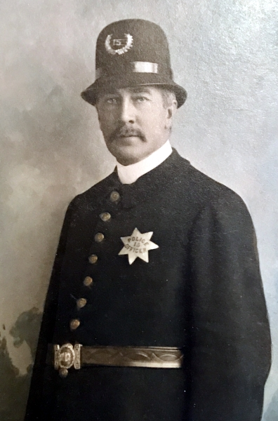 San Jose Police officer H. T. Plummer wearing badge #15.