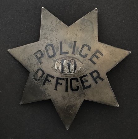 2nd issue San Jose Police badge.This huge pie plate style badge is sterling silver and at one time had a disc with a different number affixed over the original number 10.