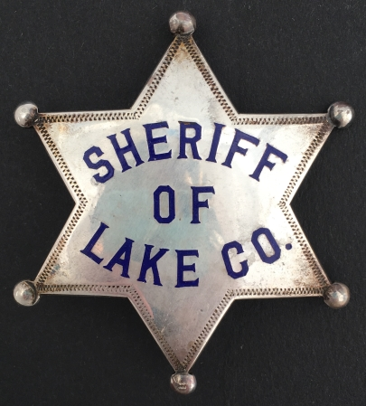 Sheriff of Lake County, CA Sheriff badge, made of sterling with hard fired blue enamel.  Last worn by Sheriff Lou McKelley, circa 1917.