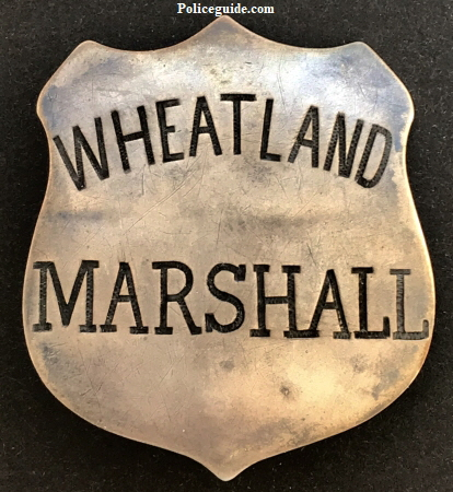Wheatland Marshall badge made of sheet silver, T-pin and C-catch.  Circa 1900.